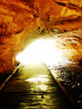 Light at the end of the tunnel. Surrealistic photo of boardwalk exiting a cave. memorial state park, columbia, missouri Stock Image