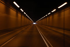 Light at the End of the Tunnel. Perspective view of a transportation tunnel with the end barely visible in the distance Stock Images