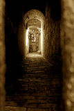 Light at end of tunnel. Doorway at the end of a spooky looking alley the light at the end of the tunnel lots of copy space on bottom Royalty Free Stock Photos