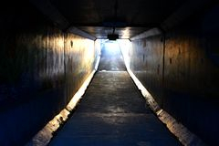 Light at End of Tunnel. Dark pedestrian tunnel with daylight shining in the end Stock Photography