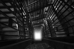 Light at the end of the tunnel. Abstract interior Stairway  surrounding structure. Looking down from top of Building. This photo has created from concept Light Stock Photos