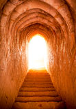 Light at end of tunnel in castle Stock Photography