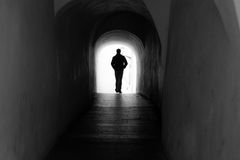 Light from the end of the tunnel. A man that goes through the darkness finally finds the light royalty free stock photography