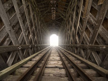 Light at the end of the tunnel. Railroad covered bridge with light at the end of the tunnel metaphor Royalty Free Stock Photos