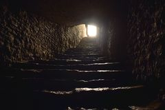 Light in the end of a tunnel with steps stock image