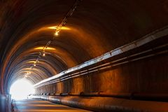 Light at the end of the tunnel, tunnel pedestrian stock photo