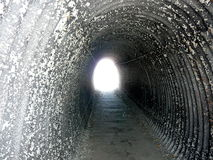 Light at the End of the Tunnel. While walking the Cliff Walk in Newport, Rhode Island we had to passage thru this tunnel, which reminded me of the saying there's Stock Photos