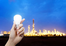 Light energy for industry, Hand holding light bulb in industrial topic Stock Photography