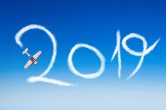 Light engine aircraft aerobatics draws in the sky figure 2019 happy new year royalty free stock image