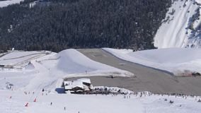 Light-Engine Aircraft Takes Off From The Mountain Airport. Light-engine aircraft takes off from the high-altitude airport ski resort. Near the Chalet and many stock video footage