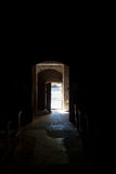 Light entering door at Church in the dark Stock Photography