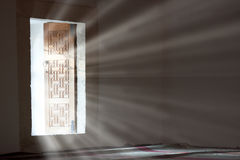 Light entering through open door Stock Image