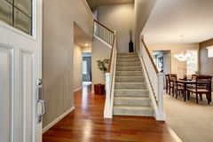Light Entryway with view of staircase, hallway and dining room. Royalty Free Stock Photo