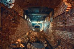Light and exit in end of dark long brick abandoned industrial tunnel or corridor or sewer channel, way to freedom concept royalty free stock photos