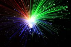 Free Light Explosion Effect On A Black Background. Flying Lights Blue, Red And Green. Stock Photo - 211740910