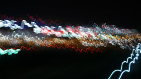 Light Explosion. Lights creating motion blur, white Illuminated dark  Background, showing a lot of small lights seen at evening and during night, urban Royalty Free Stock Images