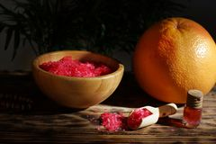 Light falls on grapefruit, salt in the scapula and massage oil.  royalty free stock photo
