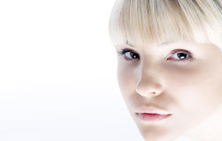 Light fashionable portrait. Light clean and fashionable portrait of beautiful blonde girl Royalty Free Stock Images