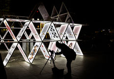 Light festival in Berlin 2015. Photographer taking images of play cards on camera connected to tripod stock photo