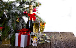 Light festive background with champagne, gifts and angel. Copy space Royalty Free Stock Photography