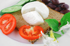 Light feta and tomatoes Stock Images