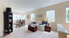 Light filled living space in beautiful two story home. royalty free stock images