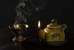 Light of fire. Oil lamp and the censer on the table stock image
