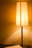 Light fixture. Modern light fixture on a hotel nightstand Royalty Free Stock Image