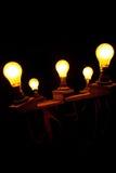 Light Fixture. Wooden light fixture holding 5 tungsten light bulbs royalty free stock photography