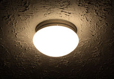 Light Fixture. On textured ceiling of home, slight sepia toning Stock Image