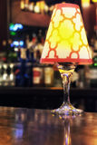 Light Fixture on Bar. A light fixture sitting on a bar Royalty Free Stock Image