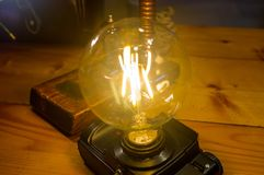 Light fixture handmade in vintage style, retro film SLR camera case. Led lamp royalty free stock photo