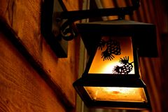 Light Fixture. Pine cone etched as silhouettes giving whimsy to the light fixture Royalty Free Stock Photos