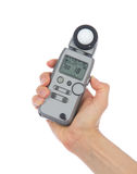 Light flash meter in hand isolated Stock Photo