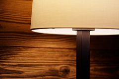 Light of a floor lamp on a wooden wall royalty free stock photo