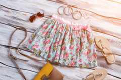 Light floral skirt and sandals. Royalty Free Stock Photography