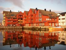 Light, Floro marina. Evening light on red buildings in Floro Marina, Norway stock photography