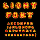 Light font. Retro Alphabet with lamps. Glowing letters. ABC poin Stock Photos