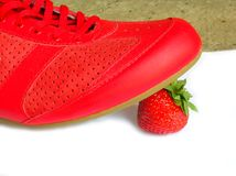 Light footware. Red footware and strawberry Royalty Free Stock Photography