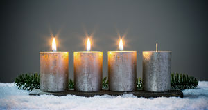 Light four advents candles with matches Stock Photos