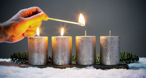 Light four advents candles with matches Royalty Free Stock Images