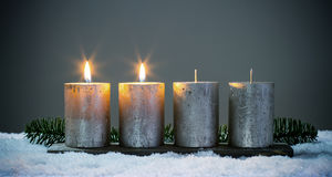 Light four advents candles with matches Royalty Free Stock Image