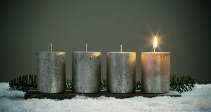 Light four advents candles with matches Royalty Free Stock Photo