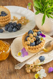 Light fresh crunchy pastry tartlet of blueberries Royalty Free Stock Image