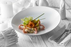 Light fresh shrimp salad with lettuce and sauce stock images