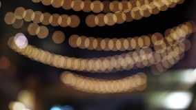 Light garland blur. Decorated for holidays stock video footage
