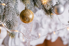 Light from the garlands. Christmas tree decorated ball close-up. Stock Photos