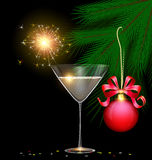 Light glass, tree and sparkler. Dark background and the glass of champagne with burning sparkler inside, branch of tree with red ball and confetti Stock Image