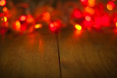 Light glitter vintage on wood  background,bokeh background,defocused .Happy Birthday,Valentine day ,Christmas lights Stock Photos