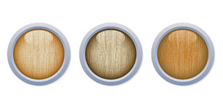 Light Glossy Wooden Buttons with metal ring Royalty Free Stock Photos